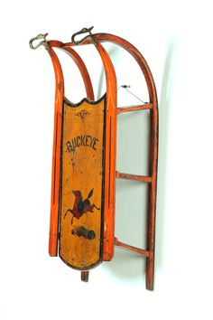 Sold for   1,763 DECORATED SLED.  American, late 19th century, pine. Original orange and yellow paint with stenciled horse and Buckeye. Cast iron goose head finials on the runners. Wear. 33l. 13w. ~♥~