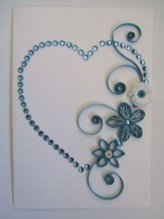Quilling heart with flowers (blue). I love the use of quilling and rhinestones… Origami And Quilling, Paper Quilling Designs, Quilling Paper Craft, Quilling Patterns, Card Patterns, Quilling Tutorial, Toilet Paper Roll Crafts, Paper Crafts, Rolled Paper Art