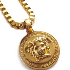 """Auth Versace Medusa Head Gold medallion necklace Auth Versace Medusa Head Matt Gold medallion pendant necklace.  Worn 2x . Unisex heavy and just stunning... Had it listed before but some1 """"accidentally"""" purchased it and cancelled...  Looks great on men and women! Chain in 12 inches long and 24 in circumference and pendant about 2.5 inches Versace Jewelry Necklaces"""