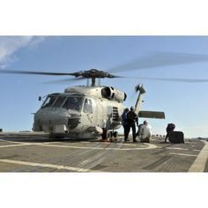 A US Navy SH-60B Seahawk helicopter is refueled on the flight deck of USS Thach Canvas Art - Stocktrek Images (35 x 23)