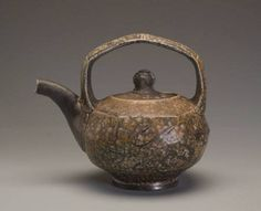 MARK SHAPIRO Multi-faceted teapot with Ash, 2009  6.5 x 9 in.    stoneware  Sold Wood-fired, salt glazed