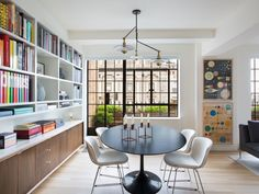 """""""I like the surprise you feel when you enter a building of this age and discover an apartment that is not what you expected,"""" says architect David Davis of Rottet Studio. """"It's a breath of fresh air."""" In the sunny New York apartment he shares with husband Brad Wilson, president of Ace Hotel Group, the homeowners' penchant for pairing classical furniture forms with more contemporary pieces is perhaps best seen in the dining area. Here, Knoll's Bertoia side chairs cozy up to the brand's…"""