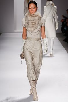 I want the scarf thing, and the boots. Elie Tahari aw11