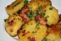 "Cartofi Taranesti - ""Country-style or 'peasant' potatoes"" -5 or 6 smallish potatoes (larger potatoes can be used but would need to be boiled longer) -One onion, roughly chopped -Two or three cloves of garlics, crushed and chopped (optional) -A scant cup of diced fatty bacon, smokey works well (optional) -Salt and pepper for seasoning -Chopped parsley (or any fresh herb you have handy) -Cooking oil (can be olive oil or even butter - again, whatever you have to hand)"