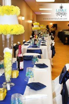 Royal blue and yellow wedding decor, tall yellow centerpieces