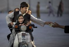 An Afghan man with his five children on his motorbike pays money to enter a park in Kandahar, southern Afghanistan, on November (AP Photo/Anja Niedringhaus) Fotojournalismus, Take A Smile, Canadian Soldiers, National Police, Killed In Action, Thing 1, Central Asia, Photojournalism, Afghanistan