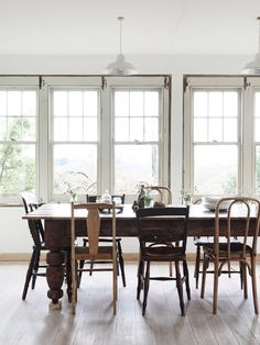 Simple dining room. Farm table. Mixed chairs.