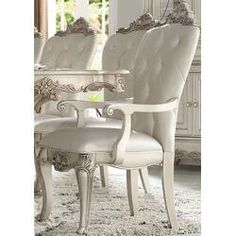 Astoria Grand This unique chair is upholstered in a cream fabric with crystal-like button tufting back. This stylish and detailed collection is ideal for a large gathering and will add elegance to any dining room decor. Solid Wood Dining Chairs, Dining Arm Chair, Upholstered Dining Chairs, Dining Room Chairs, Side Chairs, Acme Furniture, Furniture Styles, Liberty Furniture, Italian Furniture