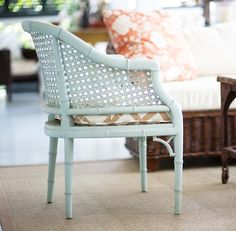 An old chair, with a can of spray paint and a great fabric can = just the right thing for a small spot in a room!