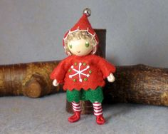 Elf Bendy Doll by Princess Nimble-Thimble - Waldorf Christmas Bendable Felt Elf Figure - Ornament    This doll stands about 2.5 and has a bendy wire