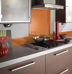 There's nothing like a pop of orange to liven up a kitchen. #kitchens #kitchenaccessories #kitchendesign #splashback #orangekitchen