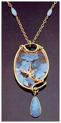 René  Lalique: as well as the use of opals, this pendant displays several feature's typical of Lalique's work: the multiple form is common to his pendent designa and the neck chain is interspersed with opal beads.