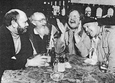 """The third photograph of Brautigan, by Roger Ressmeyer, taken in San Francisco, in 1981, shows (L-R) Curt Gentry, Don Carpenter, Brautigan, and Enrico Banducci, owner of Enrico's Cafe, a popular gathering spot at Broadway and Kearney, near City Lights Books. This photograph also illustrated Cheryl McCall's article """"A Happy But Footsore Writer Celebrates His Driver's Block"""" (People Weekly 8 June 1981: 113, 116, 120)."""