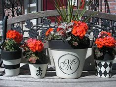 Cute ideas for painting flower pots - you could do it in any colors or designs!!!