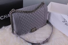 I saw a women carrying this in the city and it looked so chic! Chanel 30cm boy flap bag grey lambskin ancient silver hardware