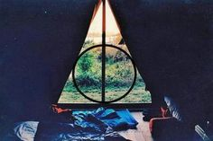 Deathly Hallows window. Visually cool and fabulously geeky! <3