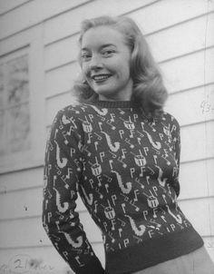 A teenage girl wearing a new music pattern sweater.  Location:US  Date taken:1945  Photographer:Nina Leen