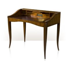 A Santo Domingo rosewood veneered and brass detailed bureau, the sloping cut out fall enclosing a gilt tooled leather writing surface, the back with pigeon holes, a pullout LED light and a fitted charging station, on splayed sabre legs with brass edging. Inspired by an Art Deco original.