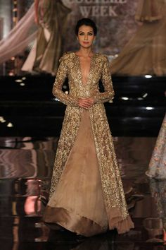 Manish Malhotra opened the India Couture Week Bollywood faces like Deepika, Katrina graced The fashion week in Delhi. Indian Wedding Gowns, Indian Bridal Outfits, Indian Gowns, Indian Designer Outfits, Indian Attire, Pakistani Dresses, Indian Designers, Pakistani Bridal, Bridal Lehenga