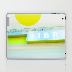 Modern library signage with graphic elements added: nearly neon yellow and pale blue plus some texture. Santa Monica Public Library v3  Laptop & iPad Skin by Cally Creates - $25.00