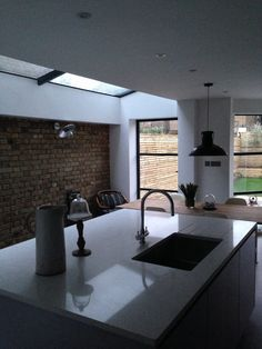 Industrial kitchen, with new side return, large ceiling glass, crittal doors and exposed brick wall. Side Return Extension, Rear Extension, Extension Ideas, Kitchen Living, New Kitchen, Crittal Doors, Porch Windows, Exposed Brick, Brick Wall