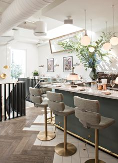 Beautiful London bar with brass stools and white marble counter top. Frenchie restaurant, Covent Garden London. Designed by Emilie Bonaventure for chef Gregory Marchand. Designs featuring on design blog: www.martynwhitedesigns.com