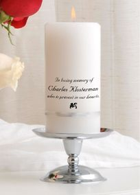 "Include the memory of a loved one in your wedding celebration with this extraordinary wedding memorial candle. It is banded in your choice of ribbon and hand printed with the phrase ""In loving memory of [name/names] who is/are present in our hearts."" Personalize by adding up to three names each with 25 characters per line.   Features and Facts:  Each name will be printed on its own line.  Set includes one 3"" x 6"" candle banded with ribbon in your choice of four colors and stand.  Choose whit..."