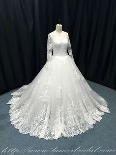 Sweetheart neckline with illusion shoulders / sleeves adorned with lace applique. Skirt features several luxurious layers of beautiful bridal tulle. The back of this gown is simply stunning and closes with a zipper. The hand-beaded detail adornment really complete this fabulous look. You will love wearing this amazing gown. This is our latest design for 2017 , So elegant, traditional and sweet.  Please let me know your size before buying. The measurements I need to create this are: Size ...
