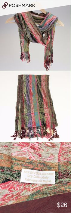 """Spring Multicolored Handmade Silk Scarf This beautiful handmade scarf is decorated with many intricate designs. It is 12"""" wide and 76"""" long (not including the tassels) which gives you plenty of length to wrap or tie however you'd like. The fabric is 50% Silk, 50% Viscose. Handmade in Nepal. Fair Trade. (#GRPBB42) Accessories Scarves & Wraps"""