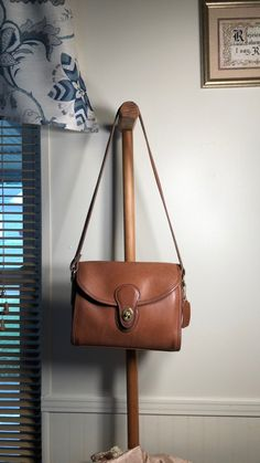 """Vintage Devon tan Coach bag. This purse is in good shape. There is a couple spots so please see the pictures. Also the owner of this purse had the shoulder strap adjusted for her so it does not have the original adjustable strap. The strap now is approximately 14"""". Coach Purses, Coach Bags, Devon, Shoulder Strap, Couple, Shapes, Pictures, Vintage, Photos"""