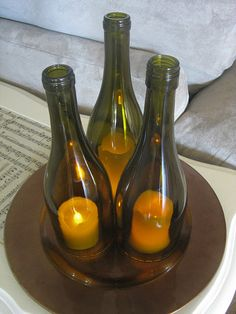 wine bottle hurricanes. Love this, especially with the vanilla candle/coffee bean idea also on pinterest