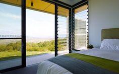 Rural home with Breezway louvre windows next to aluminium sliding door.
