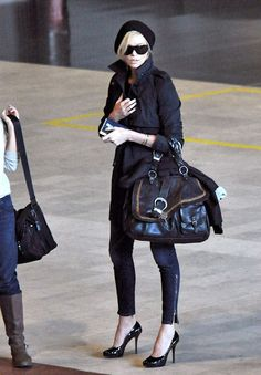 Undercover airport. Do you think she changes into sweats the moment she gets on the airplane?