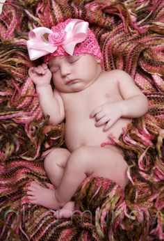 got to have my mom knit a hat to go with the blanket she made for the baby...then I want a pic like this
