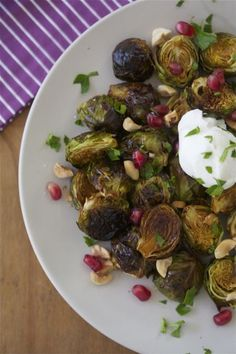 Pomegranate Molasses Brussels Sprouts with Hazelnuts via A Cozy Kitchen