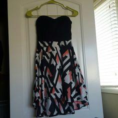 Open Back Strapless Summer Dress Cute strapless summer dress with open back. Zippered closure. Charlotte Russe Dresses