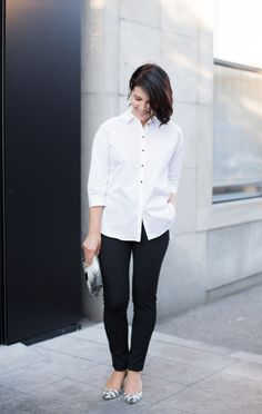 Monochrome… A Tiger of Sweden white shirt and black fitted pants, and Loeffler Randall pumps and pouch.