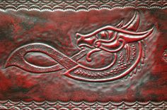 Completed Norse serpent/dragon tooling by ValkyrieLeather.deviantart.com on @deviantART