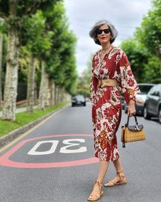 Midi dress worn with belt and flat sandals | Photo shared by Carmen Gimeno | For more style inspiration visit 40plusstyle.com