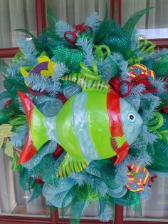 Cute Fish and Water themed Deco Mesh wreath using light blue and lime green deco mesh. By CrazyboutDeco