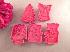 Five (5)  red plastic Christmas cookie cutters  Bell, Bear, Snowman, Angel…