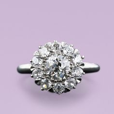 Antique Style Platinum Diamond Cluster Ring. Absolutely in love with this. I like that it doesn't look like a flower or snowflake like a lot of the other cluster rings out there.