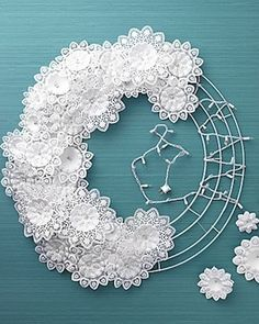 DIY- wreath made with paper doilies and a string of white lights. from Martha Stewart Holiday Crafts, Holiday Fun, Christmas Wreaths, Christmas Crafts, Christmas Decorations, Xmas, Hanging Decorations, Diy Hanging, Christmas Lights