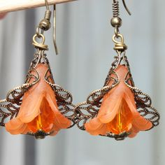 Orange Flower Lucite Earrings :  Color : Flower Lucite Frosted Orange LARGE Acrylic Flower Bead Caps  Finish : Antiqued Brass filigree flower bead