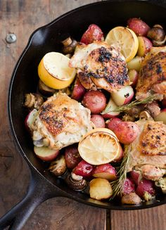 Skillet Rosemary Chicken  3/4 pound small red-skinned potatoes, halved, or quartered if large  Kosher salt  2 sprigs fresh rosemary, plus 1 1/2 tablespoons leaves  2 cloves garlic, smashed  Pinch of red pepper flakes  Juice of 2 lemons (squeezed halves reserved)  2 tablespoons extra-virgin olive oil  4-6 skin-on, bone-in chicken thighs (6 to 8 ounces each)  10 ounces cremini mushrooms, halved