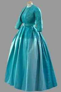 Evening dress of turquoise ribbed silk and lace w bolero and belt    Norman Hartnell    Worn by The Queen for the Marriage of Princess Margaret at Westminster Abbey, 6 May 1960.