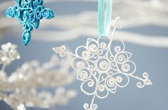 How to make our pretty paper-curled ornaments.