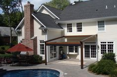 The Gennius Pergola Awning with cover and solar shade retracted