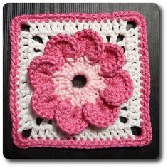 crochet flower granny square...this really looks like a flower compared to others...I'd use yellow or brown for the center, tho