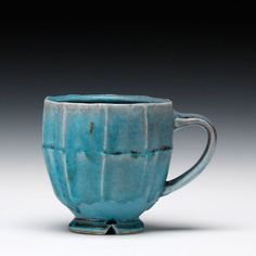 Jeff Oestreich  Description:thrown, cut, altered stoneware... soda fired with multiple glazes and latex decorationDimensions:4.25h